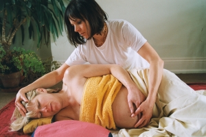 Side lying pregnancy massage connecting abdomen and head